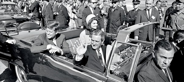 John F. Kennedy riding in limousine in Dallas at Love Field