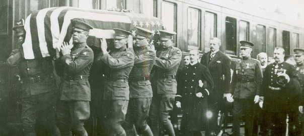 This is an image of a funeral procession outside of a train from the first World War.