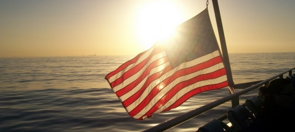 American flag on cruise ship at sunset
